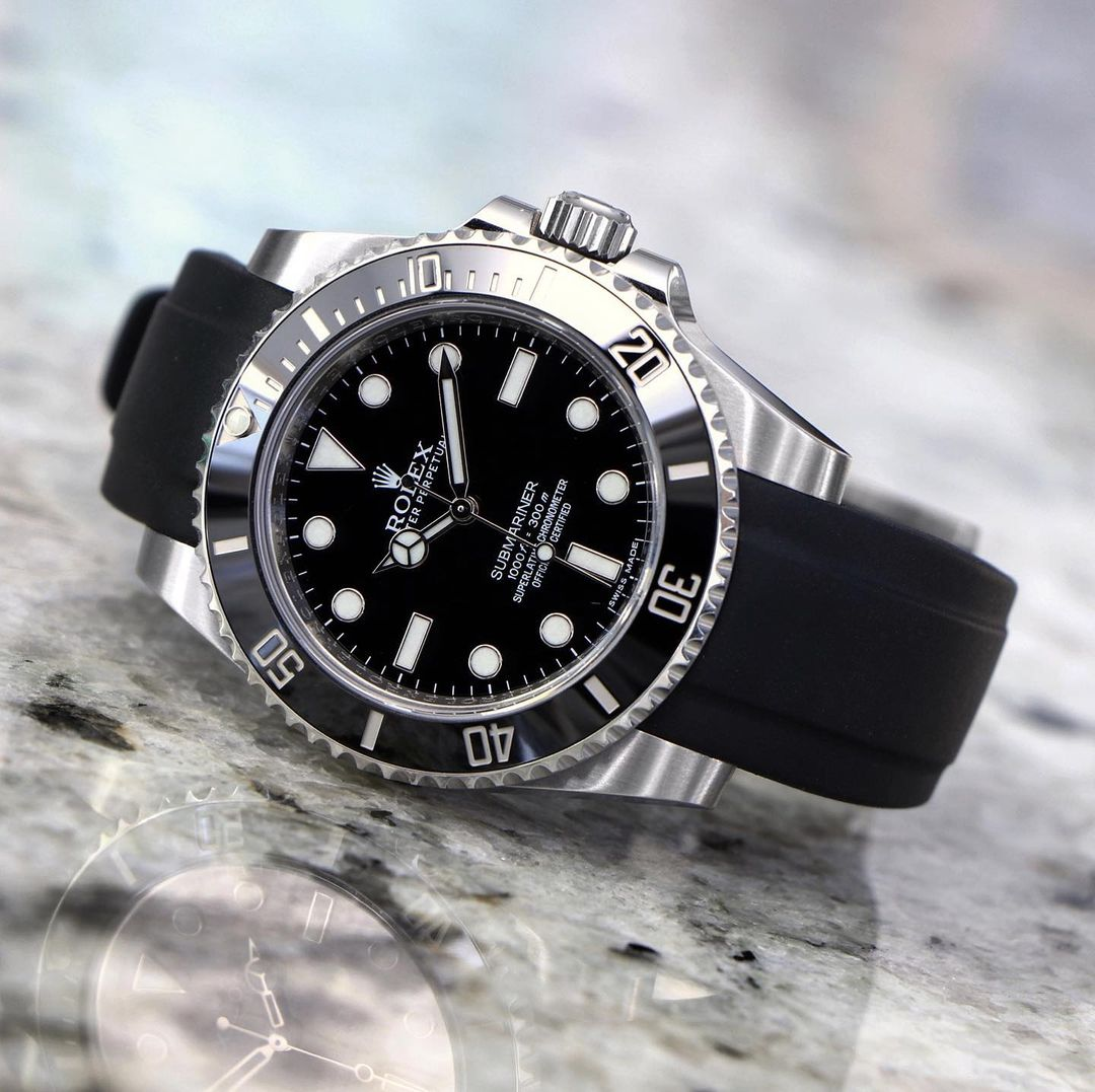 rolex sub on black rubber everest band
