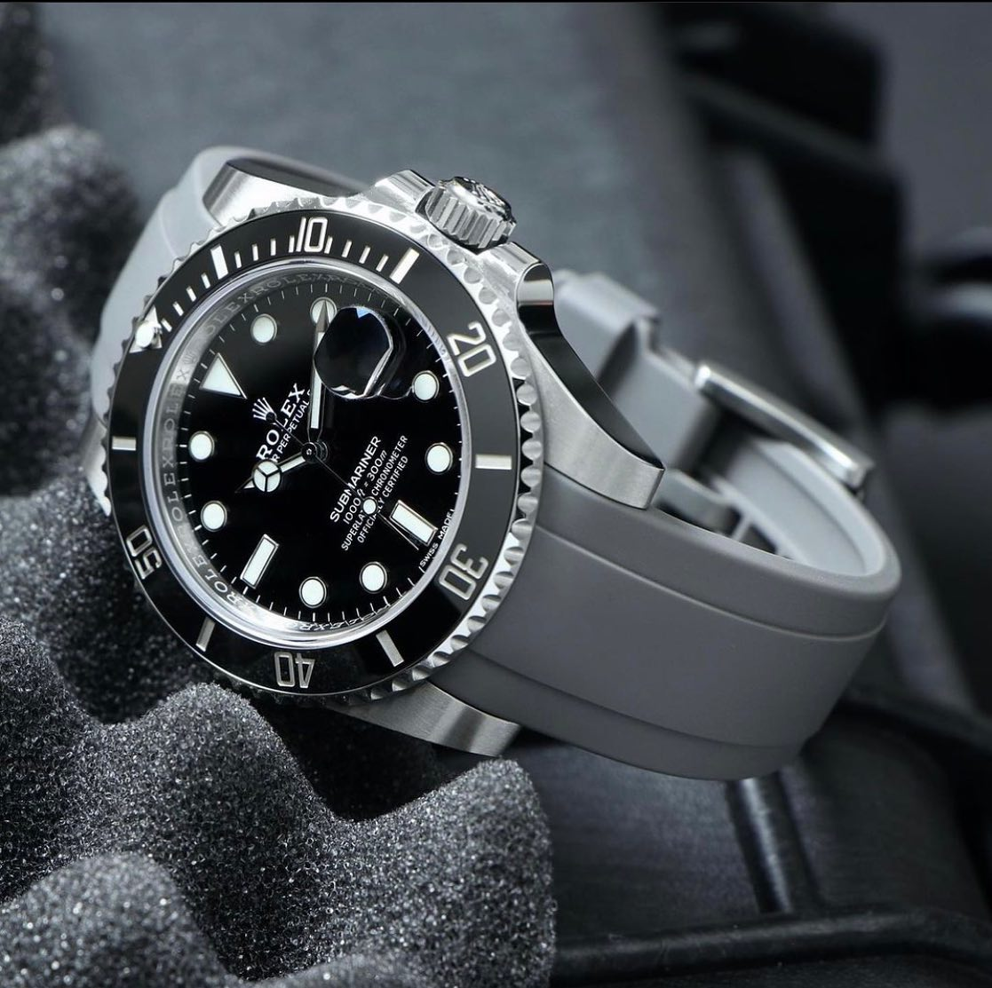 rolex submariner on gray rubber