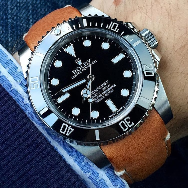 rolex submariner on tan leather