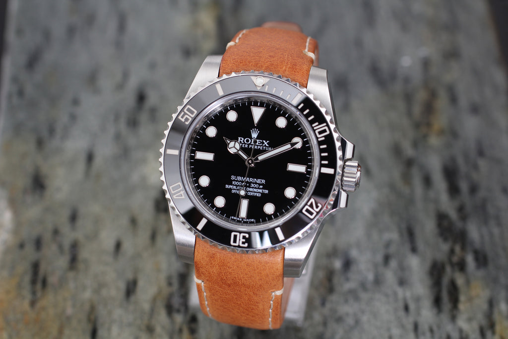 rolex submariner on tan leather strap