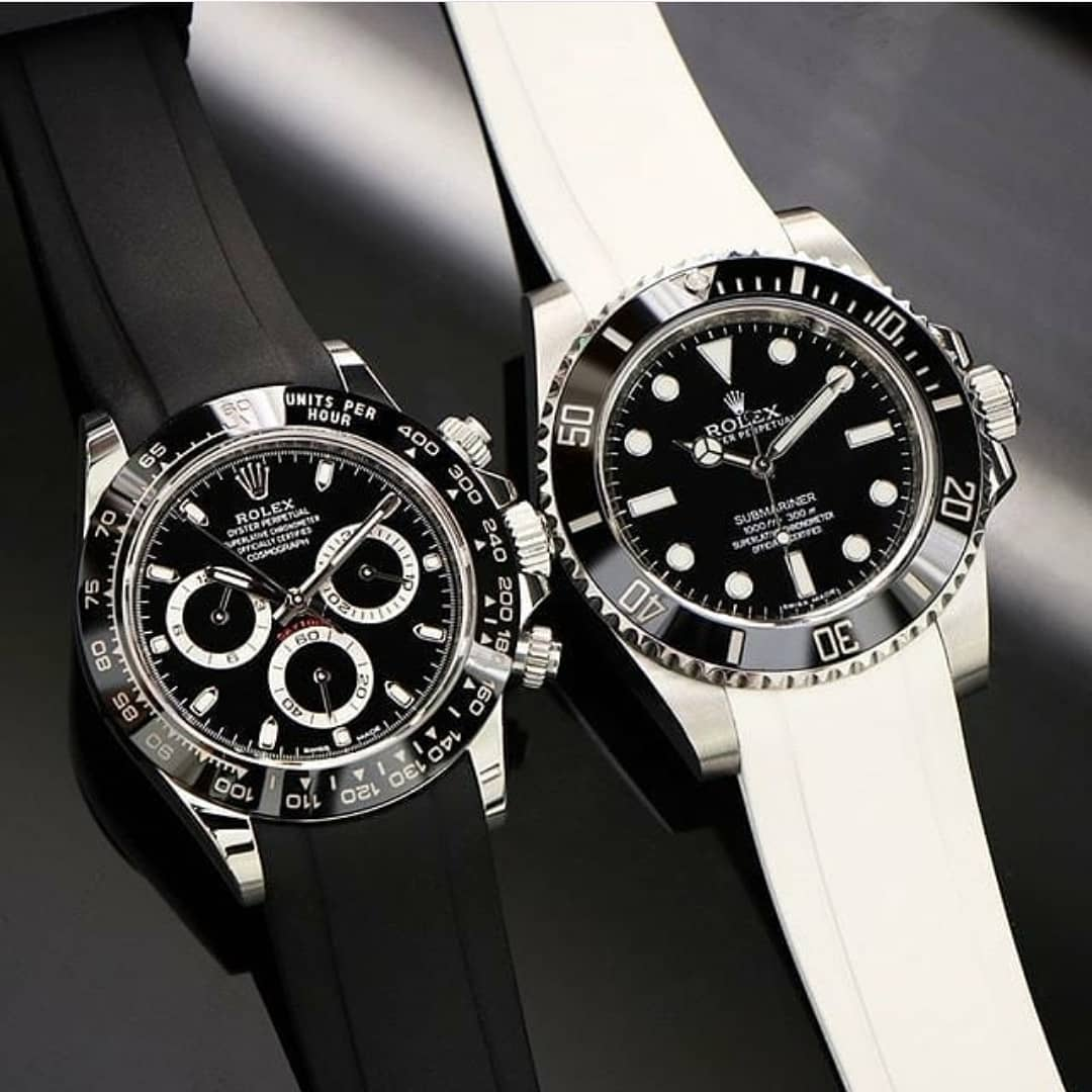 two rolex watches both on rubber straps
