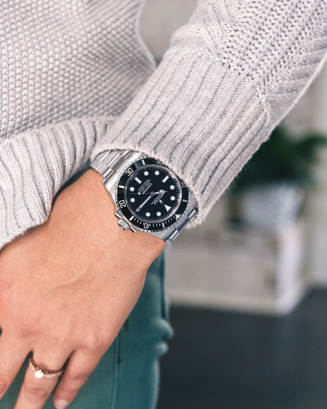 rolex submariner on a woman