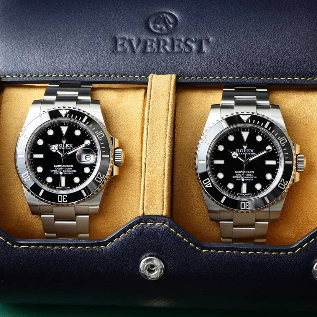 2 rolex submariners in a blue leather watch roll