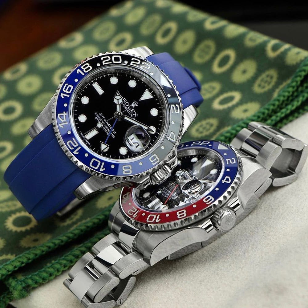 two rolex gmts one on oyster bracelet one on rubber strap