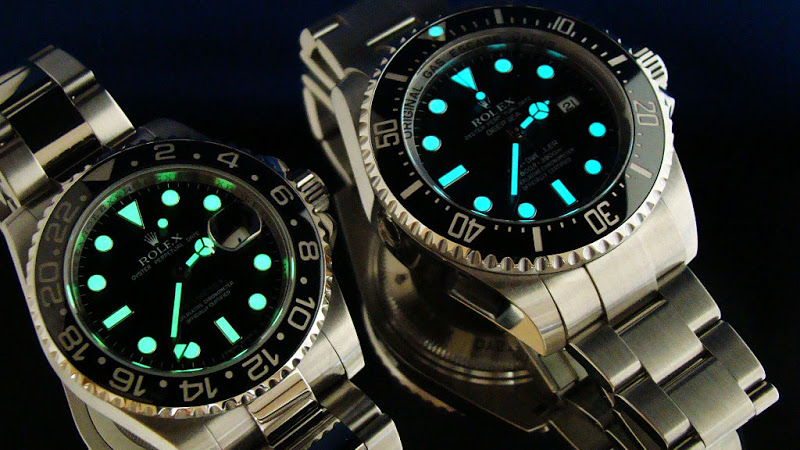 two rolex watches with lume