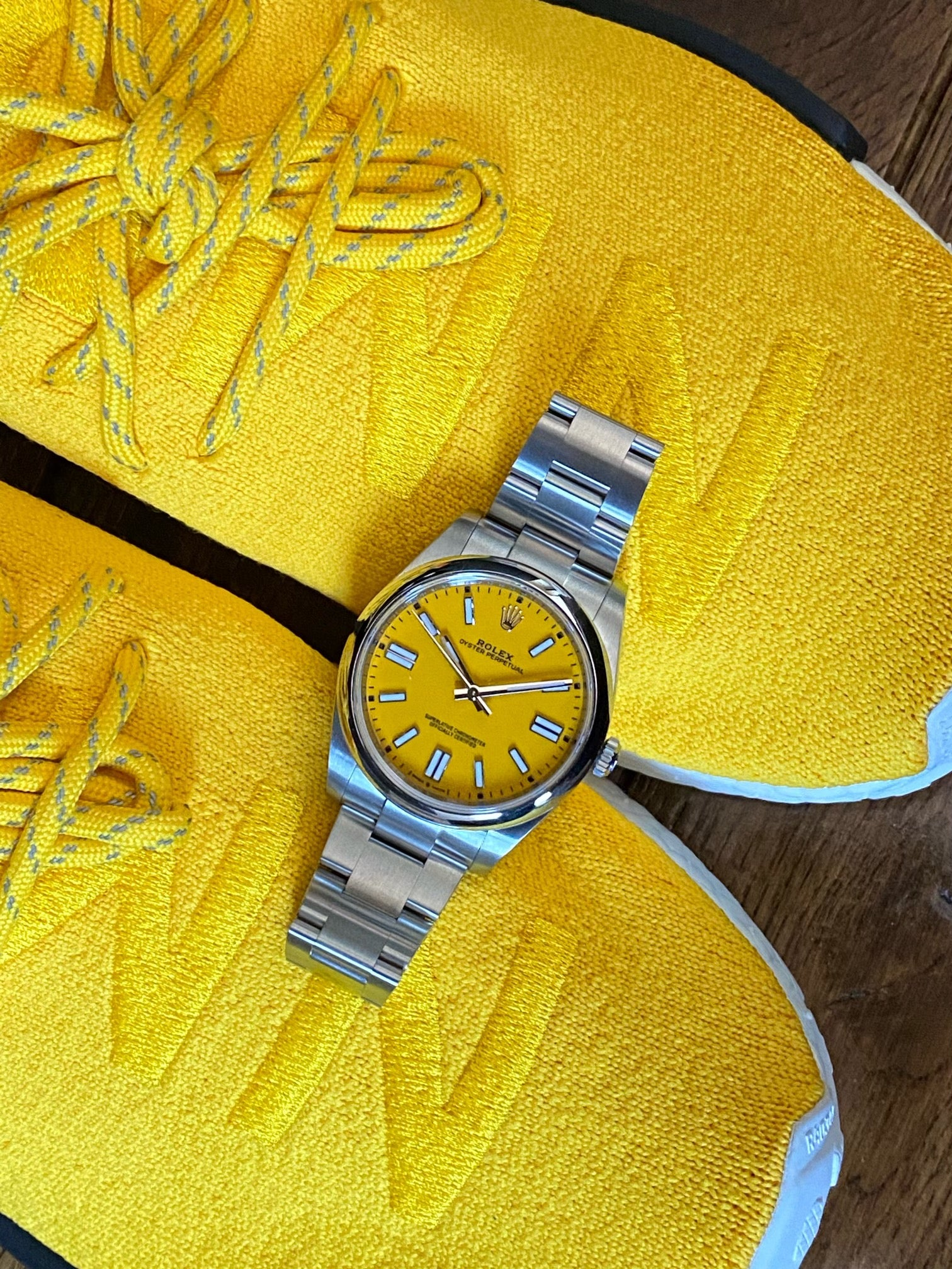 yellow rolex op41 on yellow adidas nmd shoes