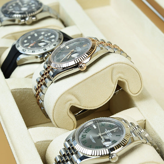 Compressible watch pillows holding Rolex watches