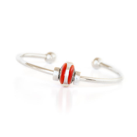 Champion bead on silver bangle bracelet