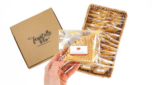 Packets of ferratelle or pizzelle of aniseed & sambuca flavour in a basket