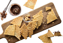 Load image into Gallery viewer, Ferratelle or pizzelle filled with chocolate and hazelnut spread served on a board