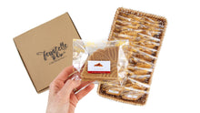 Load image into Gallery viewer, Packets of ferratelle or pizzelle of cinammon flavour in a basket