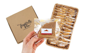 Packets of ferratelle or pizzelle of cinammon flavour in a basket