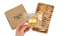 Load image into Gallery viewer, Packets of ferratelle or pizzelle of lemon flavour in a basket