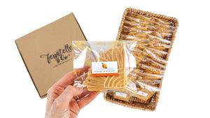 Packets of ferratelle or pizzelle of orange & almond flavour in a basket