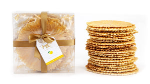 Golden Ferratelle Box with a representative tower of ferratelle or pizzelle next to it