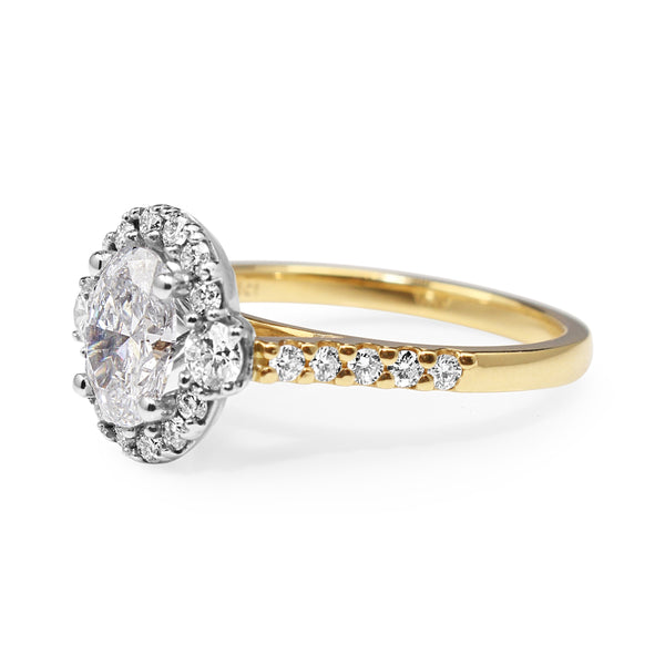 18ct Yellow and White Gold Oval Halo Diamond Ring