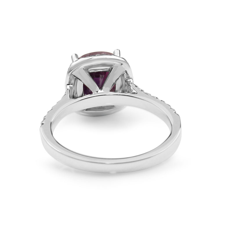 18ct White Gold Pink Sapphire and Diamond Halo Ring