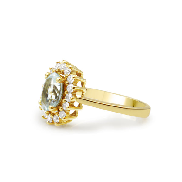 18ct Yellow Gold Aquamarine and Diamond Halo Ring
