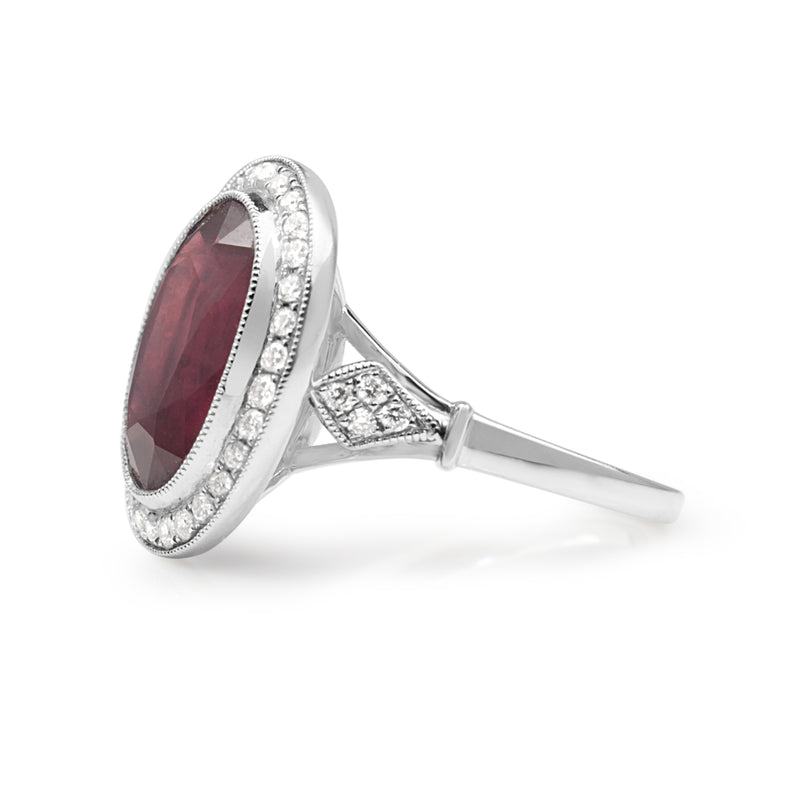 18ct White Gold Treated Ruby and Diamond Halo Ring