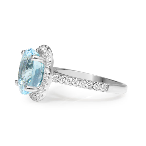 18ct White Gold Topaz and Diamond Halo Ring
