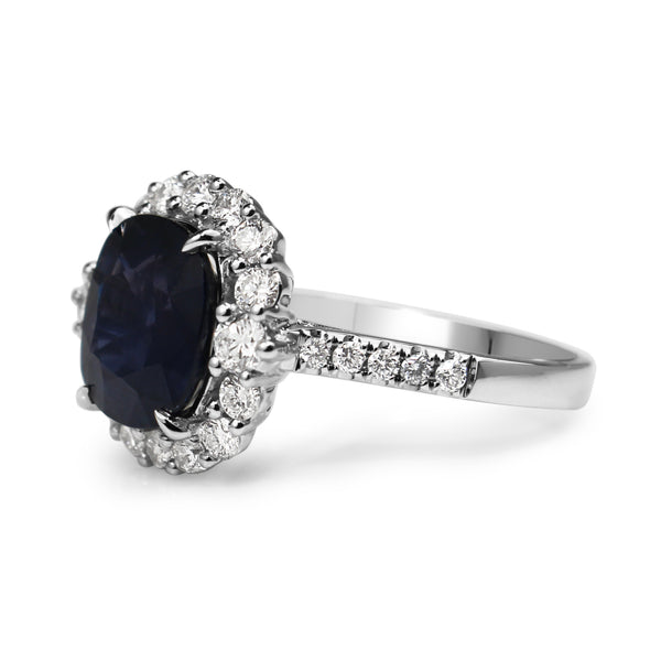 18ct White Gold Cushion Sapphire and Diamond Halo Ring