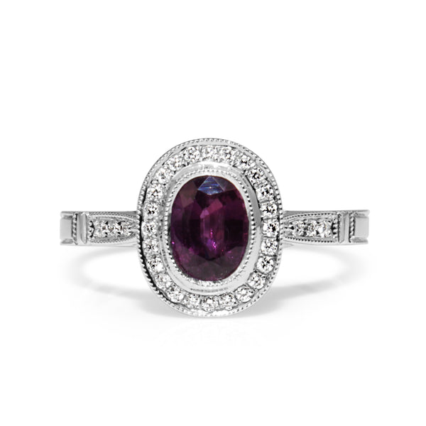 18ct White Gold Purple / Pink Sapphire and Diamond Halo Ring