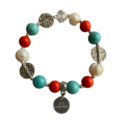 Drift Away elasticated bracelet with orange howlite, freshwater pearls, magnesite, Swarovski crystal