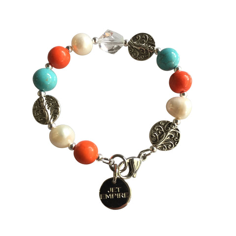 Drift Away bracelet featuring orange howlite, freshwater pearls, magnesite and Swarovski crystal