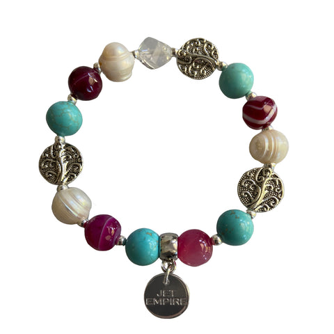 Drift Away elasticated bracelet featuring pink agate, freshwater pearls, magnesite and Swarovski crystal
