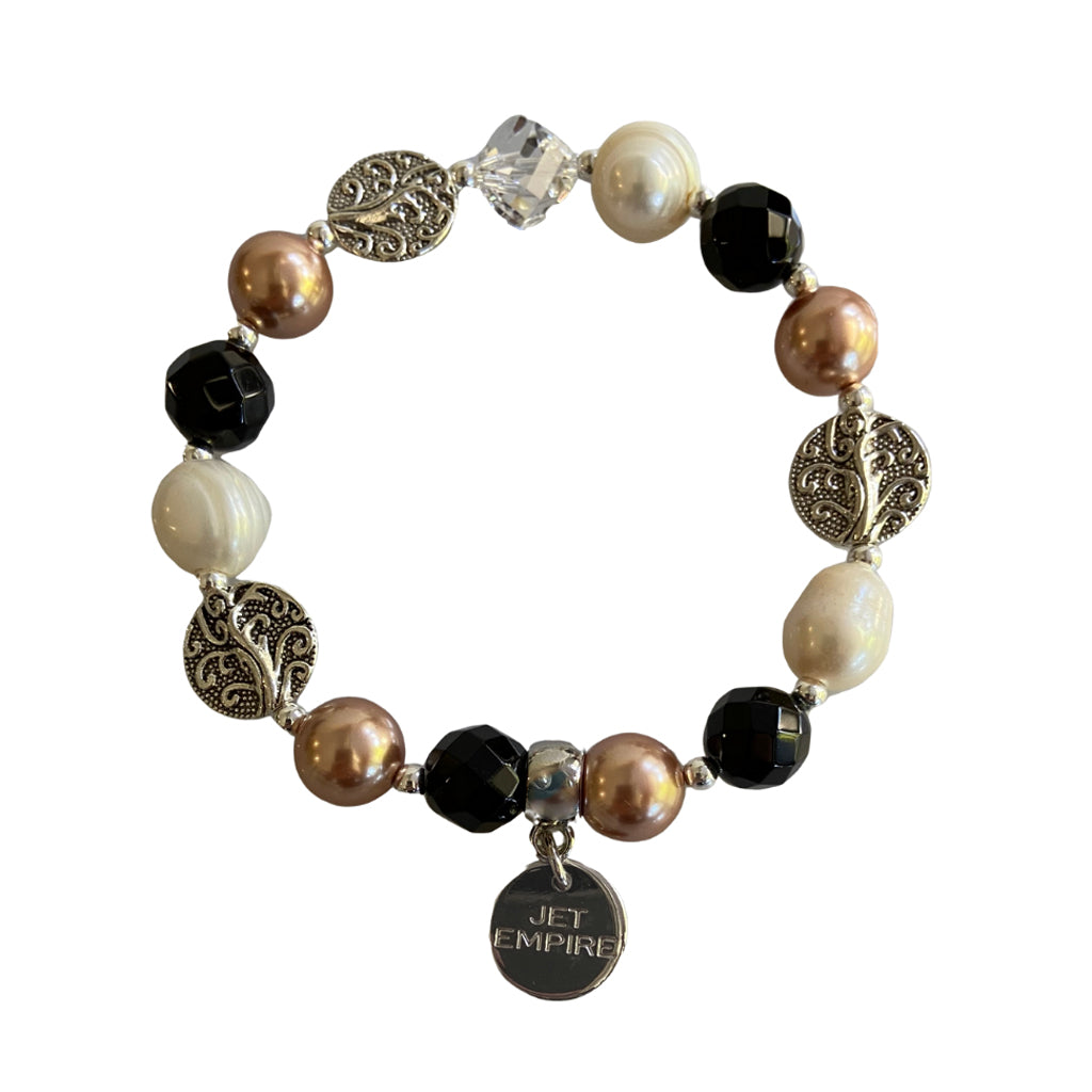 Drift Away elasticated bracelet with onyx, freshwater pearls, Swarovski Rose Gold pearls, Swarovski crystal