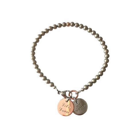 One Dance Swarovski Platinum pearl bracelet with 14K rose gold feature bead and Let's Dance charm