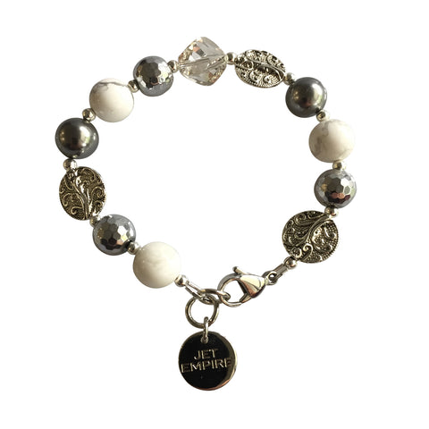 Drift Away bracelet featuring white howlite, hematite, Swarovski grey pearls, Swarovski crystal