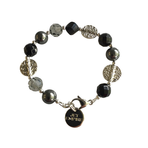 Drift Away bracelet featuring onyx, Swarovski black diamond crystals, Swarovski grey pearls, Swarovski jet crystal