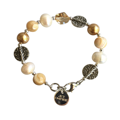 Drift Away bracelet featuring mother of pearl, freshwater pearls, Swarovski gold pearls, Swarovski golden shadow crystal