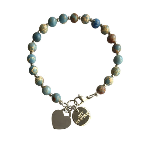 Under Pressure Light Blue Magnesite bracelet with stainless steel lock heart charm