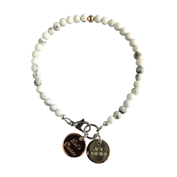 Mountain Sound bracelet featuring White Howlite and a 14K Rose Gold feature bead and Let's Dance charm