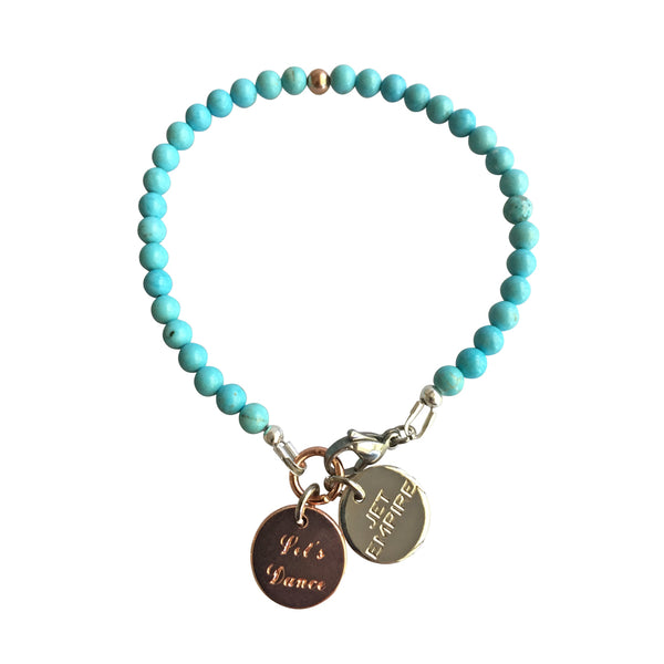 Mountain Sound bracelet featuring Magnesite and a 14K Rose Gold feature bead and Let's Dance charm