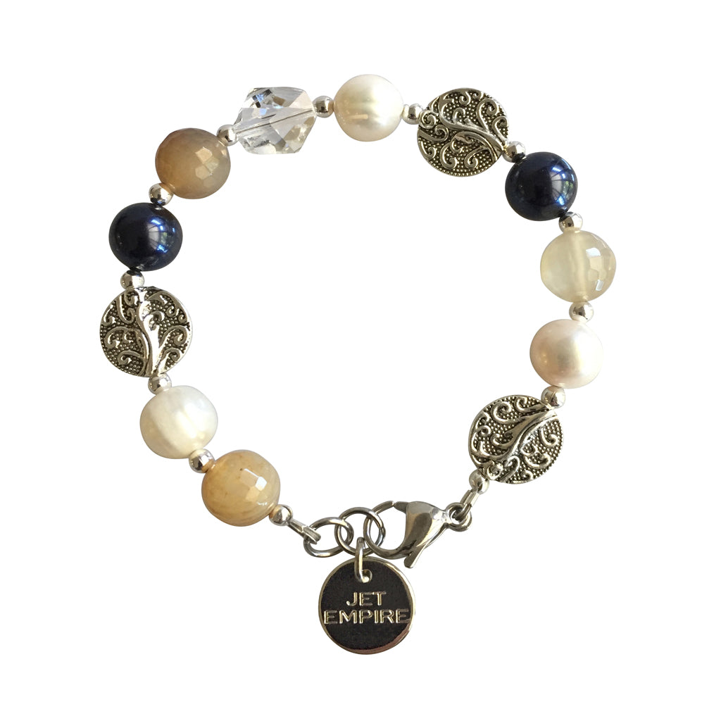 Drift Away bracelet featuring agate, freshwater pearls, Swarovski Night Blue pearls and Swarovski crystal