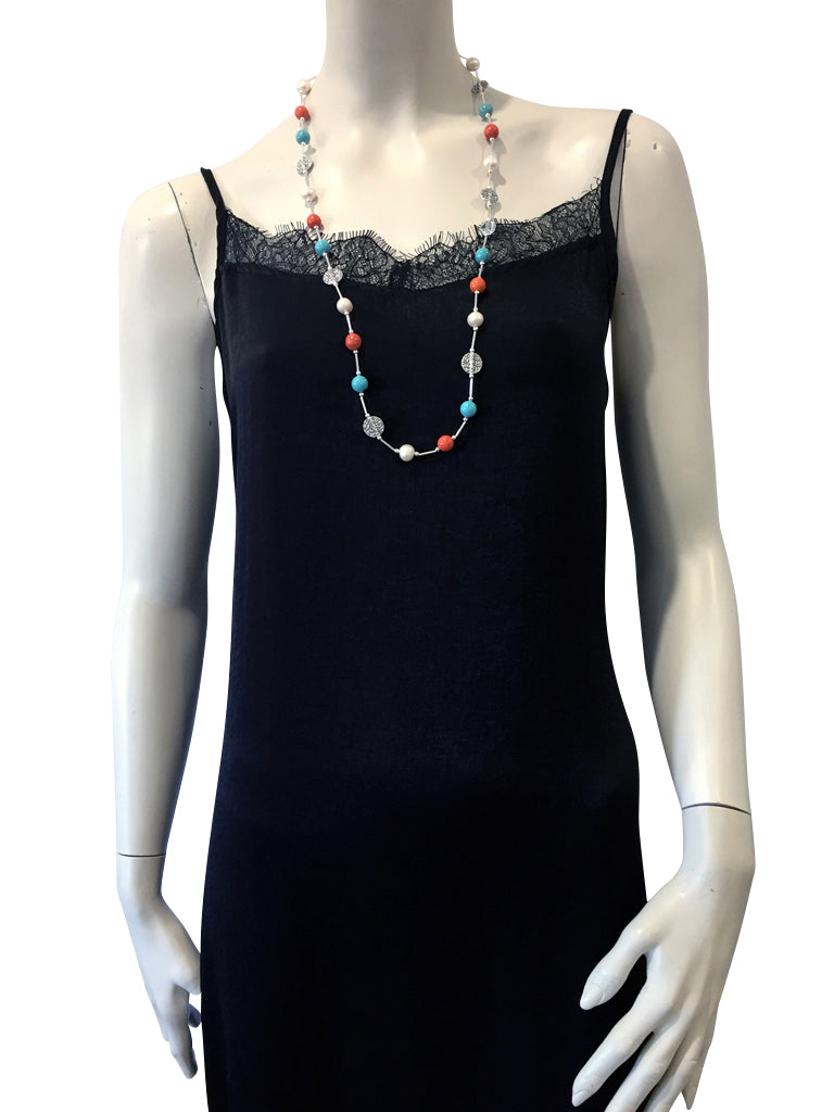 Mid length necklace with Orange Howlite, Freshwater Pearls, Magnesite and Swarovski crystal