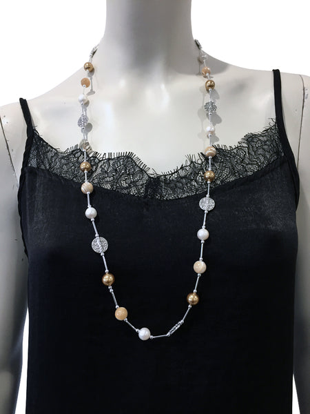 Mid length necklace with Mother of Pearl, freshwater pearls, Swarovski Gold pearls and Swarovski Golden Shadow crystal