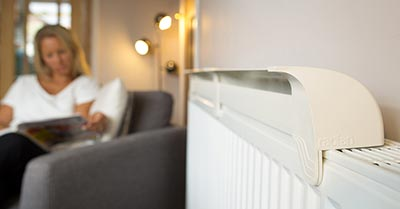 Radfan long on radiator with lady in background