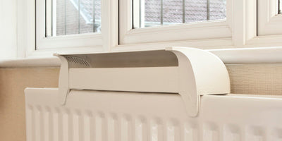 Radfan on radiator under a window