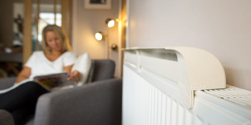 radfan on radiator in living room while reading