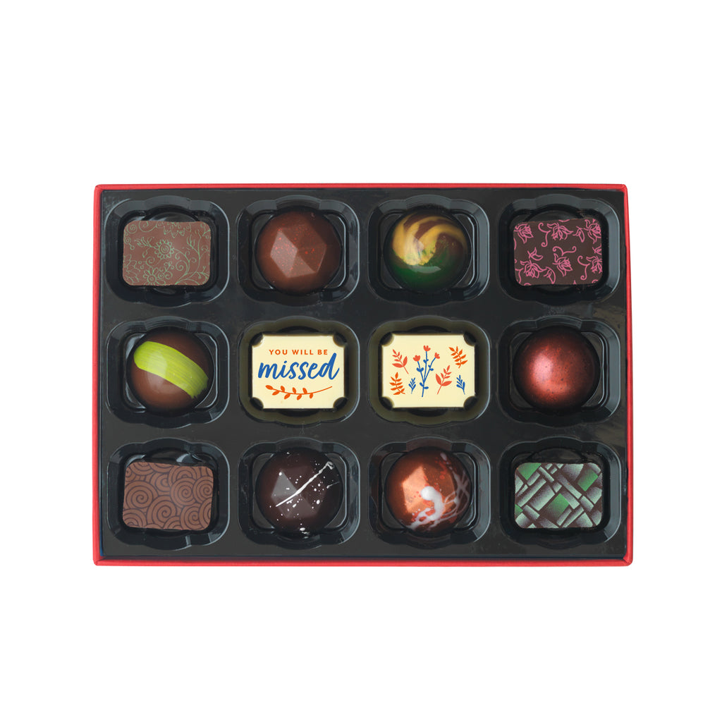 Luxury chocolate gift box of 12 chocolates for leaving occasions. Selection of 12 milk, dark, and white chocolates. The box includes 2 leaving chocolates, popular hand painted and caramel chocolates