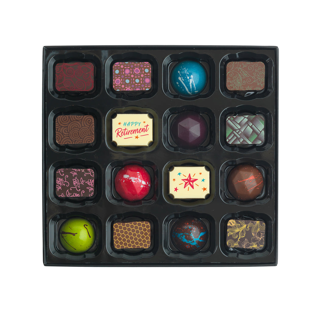 Selection of 16 milk, dark, and white chocolates. The box includes 2 retirement chocolates, popular hand painted and caramel chocolates
