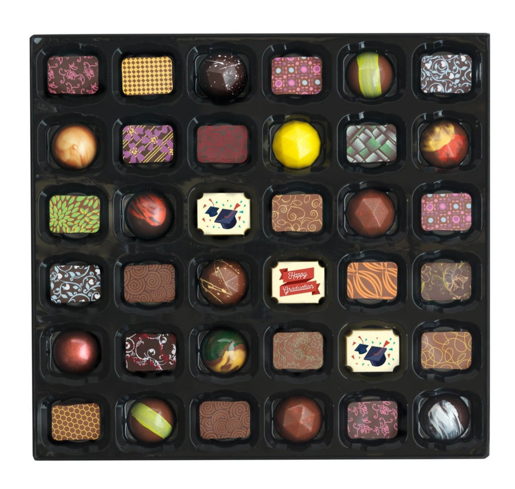 Selection of chocolates for a happy graduation occasion. The box consists of three birthday chocolates, popular caramel chocolates and beautifully hand painted chocolates.
