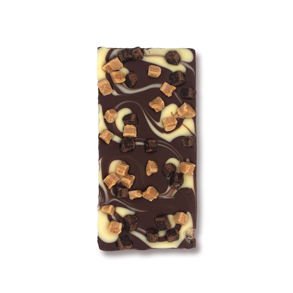 Caramel and brownie chocolate bar with fudge pieces in milk and white chocolate
