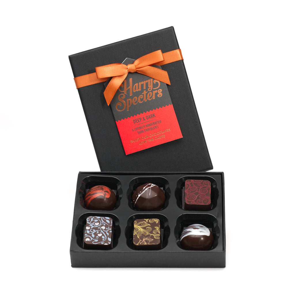 Selection of six dark chocolates. Natural ingredients and ethically sourced chocolate is used in making these gourmet chocolates