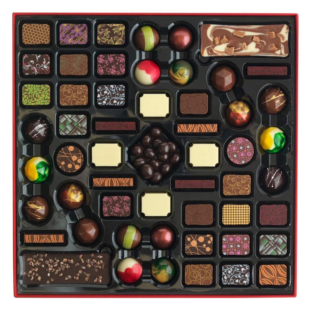 Chocolate gift box that you can personalise with 4 printed chocolates. The box contains a delicious mix of milk, dark, and white chocolates. Included in the box are slabs, filled chocolates, batons, discs, and chocolate covered coffee beans.