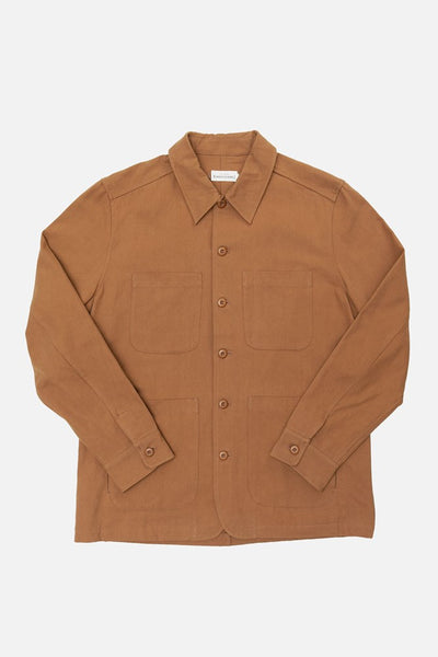 Light Brown Unlined chore coat with chest pockets, dual-entry hand pockets, and shoulder gussets